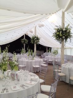 Wedding marquee pole flowers