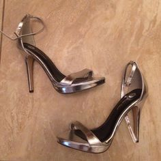 """Jaxine Heels Up for grabs is a pair of silver metallic """"Jaxine"""" heels from m by Michael Antonio, size 8. In good condition! Has a small blemish, it is lifting in 1 area. ❌Trades ❌PayPal ✅Offers Same day/next day shipping M by Michael Antonio  Shoes Heels"""