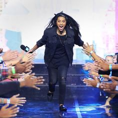 We love what this lady @iisuperwomanii is all about! SUAVS is a women run business and we fully support #girllove .  Lilly Singh wearing her Black on Black SUAVS on stage. #suavsshoes #suavslife #girlpower