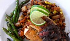 Tobasco seared Wahoo, sweet potato & corn hash, sauteed asparagus finished with a black bean sauce