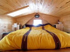 Kyle and Jessica's tiny house. We are thinking about this type of roof. It really gives you a lot more space. Love the sky light.