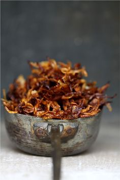 CRISPY FRIED SHALLOTS aka HANH PHI aka BAWANG GORENG why a pin for such a simple garnish? different oils. different prep. worth a go. recipe gateway: this post's link AND http://www.vietworldkitchen.com/blog/2007/11/crispy-carameli.html AND http://whattocooktoday.com/how-to-make-fried-shallots-crisp.html AND http://theasiangrandmotherscookbook.com/2011/11/10/fried-shallot/ [Andrea Nguyen] [vietworldkitchen] [whattocooktoday] [theasiangrandmotherscookbook]