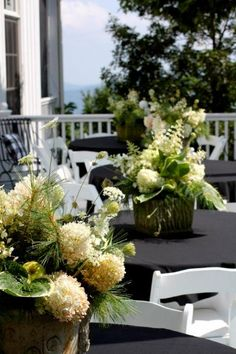 All Things Farmer: A Mountain Party. Table decor with hydrangeas, pine, and apples.