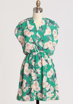 "Floral Twilight Dress 42.99 at shopruche.com. Rich with countless blooms, this silky green dress is decidedly chic with an alluring surplice neckline and a defining elasticized waist. Pair with bangles and open toed heels for a look that is playful and fun.100% Polyester, Made in USA, 34.5"" length from top of shoulders"