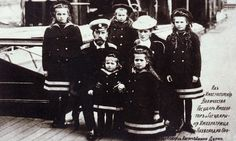 Tsar Nichols II with Empress Alexandra and several of their children.