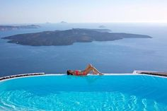 Relaxing in Santorini, Greece.,...yes right there where she is alignment!  http://georgiapapadon.com/