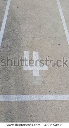 Concrete floor with number four with light and shadow - stock photo