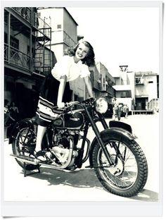 Rita Haywork on a Triumph motorcyle