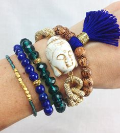 Emerald City Boho Bracelet Stack featuring jewel tones, buddha bracelet and tassels by dAnn on Etsy