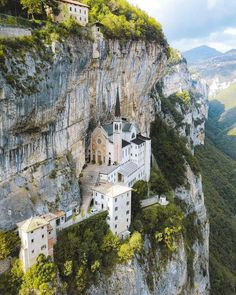 This church built into the edge of the mountain in Italy