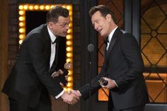"""Simon Stephens (L), the author of """"The Curious Incident of the Dog in the Night-Time,"""" accepts the award for Best Play from presenter Bryan Cranston. REUTERS/Lucas Jackson"""