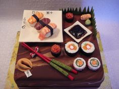 Sushi cake - I made this cake for a sushi lover! This is a red velvet cakes with creamcheese covered with fondant. Decorations and sushis are all edible fondant and pearl candy. The soya sauce is chocolate jelly. I wrote the jubilee name in japanese on the plate.