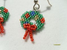 Christmas Wreath Earrings with 3D bow. $12.00, via Etsy.