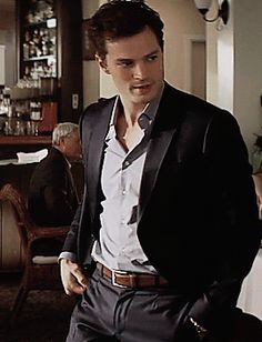 """""""Ms. Steele,"""" he says leaning on the bar looking at me. """"I thought that was you.""""  """"Hello, Mr. Grey,"""" I tell him, purposely turning in his direction. """"It's very nice to see you again.""""  """"Is it,"""" he asks and he can't help the smirk that is fighting to show on his face.  """"Yes, very,"""" I tell him."""