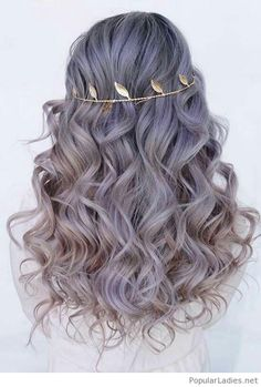 Amazing curly grey hair and a gold headband