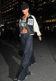 Every day is Throwback Thursday for Rihanna, who was spotted rocking some serious bell bottoms while holding her flip phone into a meeting with Jay-Z.