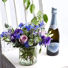 ⭐️⭐️⭐️⭐️⭐️ 5 star review: Great experience Flowers and bubbles delivered on day requested and looked so amazing. Will def use them again. Blue Delphinium, Lilac Roses, Vase Arrangements, White Vases, Flower Delivery, Glass Vase, Bubbles, Bloom, Star