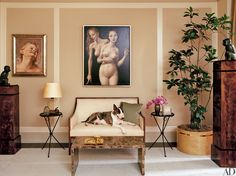 Marc Jacobs's master bedroom boasts six paintings by John Currin, a pair of Lalanne bronze monkeys, two Dominique armchairs covered in a Holly Hunt fabric, and an Alberto Giacometti floor lamp. The Jansen dresser and mirror are from Bernd Goeckler Antiques. Neville surveys the scene from a vintage settee; the low table is by Jean-Michel Frank.