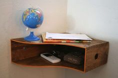 A catch-all corner shelf made from magazine holder.