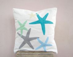 Decorative throw pillow: starfish in pastel  blue, green, turquoise and grey