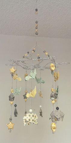 Beautiful baby mobile with origami elephants, birds and stars in yellow, grey and aqua colros on Etsy, $93.00