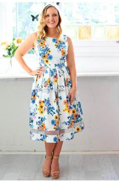 High Tea Dress in Blue Floral $59.90  The High Tea Dress welcomes spring with its fresh colours and classic cut.  Slip into this ultra-flattering mid-length style dress complete with accentuated waist band, circle 0 style, pleat skirt and fitted bodice.  With a mesh splice above the hemline the gorgeous orange and blue floral print is bright against the fresh white background.  Nip in the waist with the tie back for extra shaping.