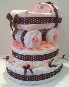 Baby carriage diaper cake http://babyfavorsandgifts.com/baby-carriage-diaper-cake-base-p-286.html