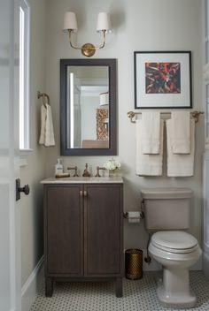 circa lighting sconce. beautiful small bathroom.