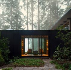 Architect Jim Olson expands tiny cabin he built 60 years ago in rural Washington - series of additions to a bunkhouse   constant reuse and integration of the existing structure   wood, steel, plywood, recycled boards, glass   wood, cabin, retreat, vacation home, natural materials
