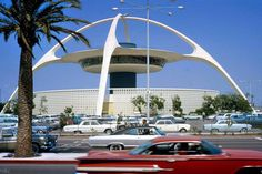 """LAX Theme building in 1967 - an example of Mid-Century Modern Architecture known as """"Googie"""" or """"Populuxe."""" The distinctive white building resembles a flying saucer that has landed on its four legs. Designed by a team of architects and engineers headed by William Pereira and Charles Luckman, that also included Paul Williams and Welton Becket. The initial design of the building was created by James Langenheim, of Pereira & Luckman."""