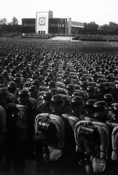 Hitler believed the American army was a joke. Here, at a rally, thousands of German soldiers stand proud. America would prove Hitler wrong.