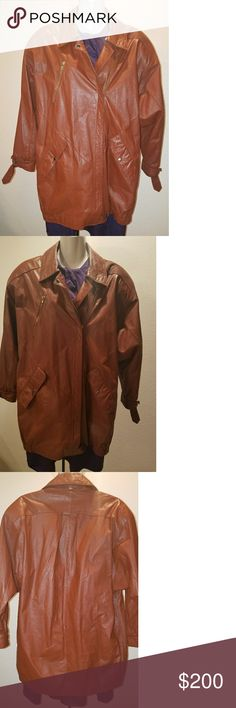 "Vintage Avanti genuine leather jacket 34"" long. Beautiful color. Was thoroughly inspected and I didn't find any defects. Has an optional strap that can be attached to the collar (the end of that piece has minor wear and tear). 34""  long. Side button pockets. Loose fit style and can fit a size small or medium. Can be rolled up or down at the wrist and has pull through ties. Avanti Jackets & Coats"
