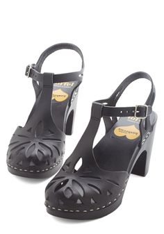 By the Light of the Starburst Heel. Each time you fasten the silver buckles of these black T-straps by Swedish Hasbeens, your excitement lights the way! #black #modcloth