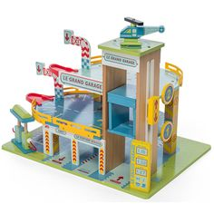 Le Toy Van's Le Grand Garage is a three storey parking garage with a working lift. Wooden Toy Garage, Wooden Toys, Van Kitchen, Dino Toys, Pompe A Essence, Hot Wheels, Gas Pumps, Car Set, Garages