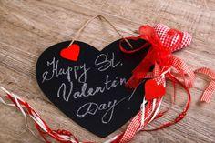 valentines day black heart on wooden background