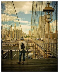 The Brooklyn Bridge, one of the oldest suspension bridges in the United States, stretches 5,989 feet (1825 m) over the East River, connecting the New York City boroughs of Manhattan and Brooklyn .