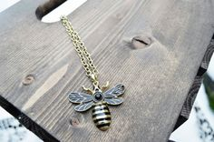 Gold Save The Bees Pendant Necklace by WildLivesShop on Etsy