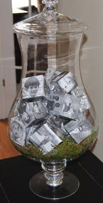 DIY -Family Picture cubes in clear vase. Template included. Love this decorating idea for a cute coffee table, entry hall or buffet table. It would be cute to put some sand and shells in one with your vacation pics on the cubes or something else symbolizing your travels. Like a vacation memory jar.
