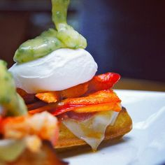 lobster benny on a waffle with gruyere, plum tomato jam and chive hollandaise