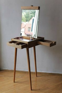 "Dressing Table ""Molbert"" - is an easel formed peace of furniture. It has three drawers for accessories and a mirror, made of beech wood. Designed by Ana Tavartkiladze."