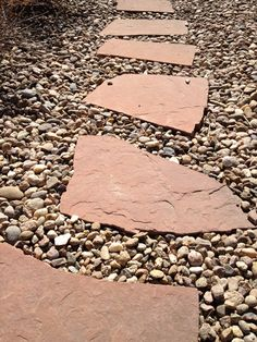 stone pathway designs | Flagstone stepping stones with river rock landscaping idea