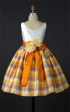 #ElizabethStJohn- Kelly orange flowergirl dress can be obtained through #SoliloquyBridalCouture