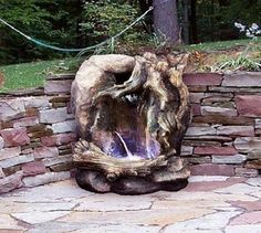 Rustic Looking Fountain with Log Holder