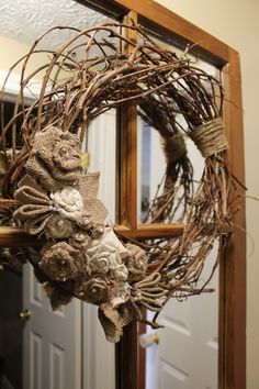 Grape Vine Wreath with Canvas and Burlap Rosettes, Twine, and Some Pearls.... All you need is grapevine, canvas or drop cloth, burlap, and twine.. add some cute pearls and Voila!