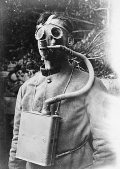 The First World War: The French Tissot mask demonstrated by a French soldier. The Tissot mask was revolutionary in that it gave the wearer greater visibilty by allowing air to pass over the eye-pieces, Arras.