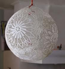 Put wallpaper glue on the lace. Hang the ballon on a string and put the soaked lace on the baloon. They have to overlap eachother so they will stick together and connect.  I always put on onother coat of extra glue when thay are all on the baloon.  Just to be sure.