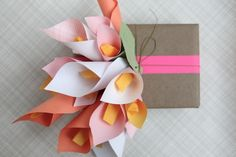 Cute gift wrapping idea. Love the paper flowers. Flowers would be cute on wreath...