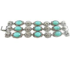 Vintage Multi Strand Turquoise Blue Bracelet  Big, bold and chunky three strand statement bracelet.  Approximate Measurements:  7 inches in