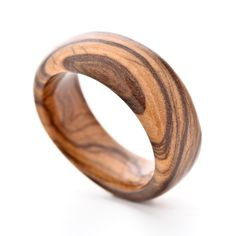 This impressive wooden ring is crafted from a mature African White Olive and has a purely natural finish. As with all handmade genuine wooden rings, each …