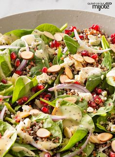 Quinoa lends its nutty flavor to a spinach salad that& as lovely as it is delicious, topped with toasted almonds and tasty pomegranate seeds. Quinoa Spinach, Spinach Salad Recipes, Vegetable Recipes, Vegetarian Recipes, Healthy Recipes, Easy Recipes, Healthy Cooking, Healthy Eating, Cooking Recipes